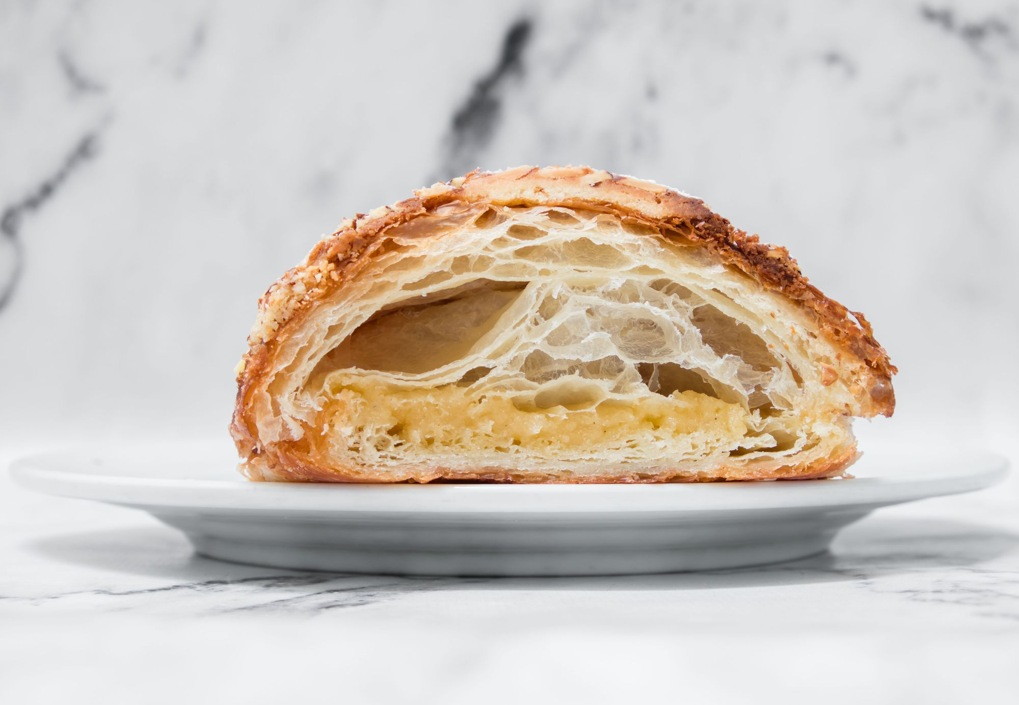 Small Victory Almond Croissant ($5) - Cross Section